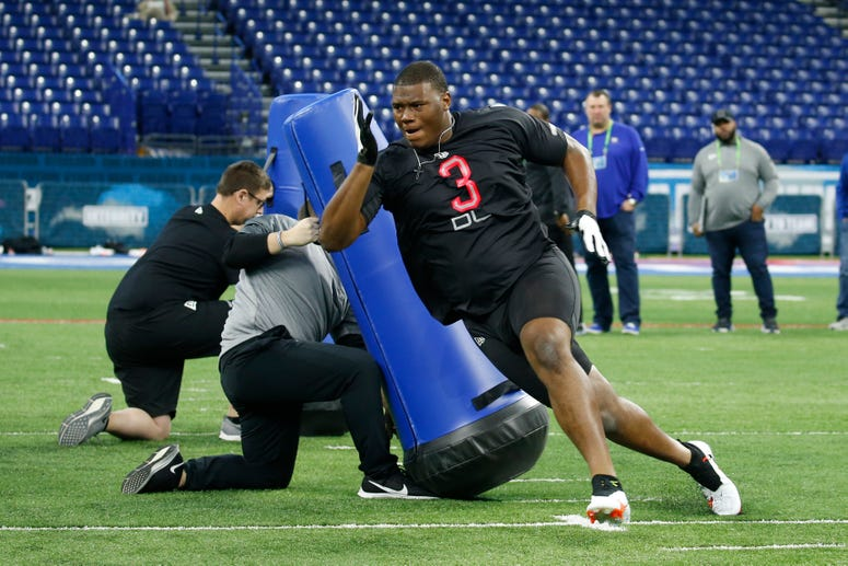 Auburn Tigers defensive lineman Derrick Brown (DL03) goes through a workout drill during the 2020 NFL Combine at Lucas Oil Stadium.