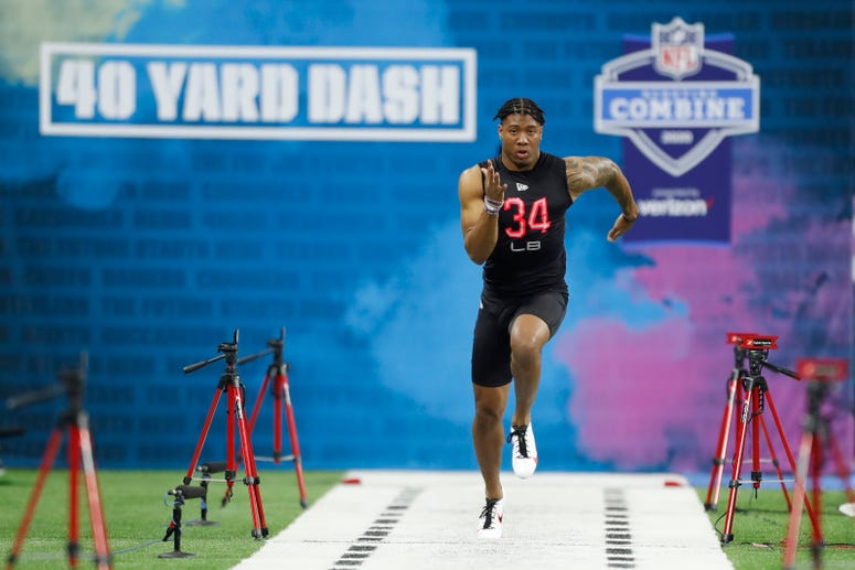 Clemson Tigers linebacker Isaiah Simmons (LB34) runs the 40 yard dash during the 2020 NFL Combine at Lucas Oil Stadium.