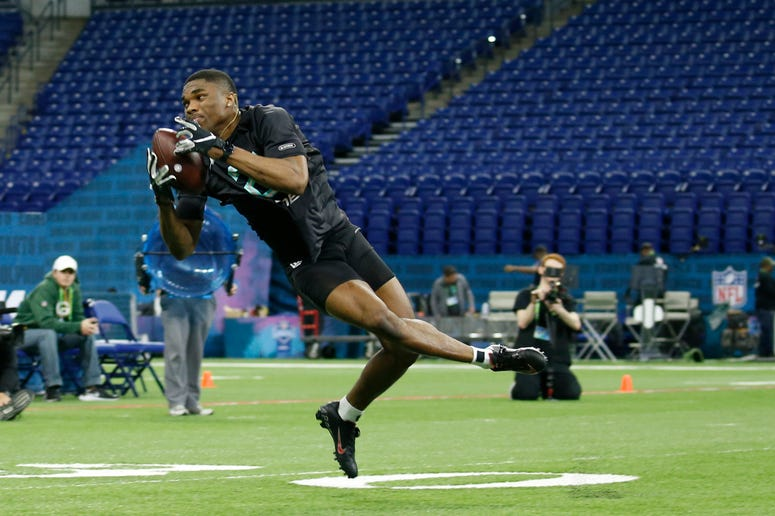 Ohio State Buckeyes defensive back Jeff Okudah (DB24) makes a catch during a workout drill during the 2020 NFL Combine at Lucas Oil Stadium.