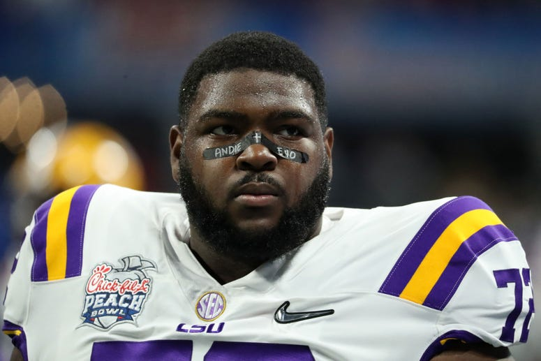 LSU Tigers nose tackle Tyler Shelvin (72) warms up before the 2019 Peach Bowl college football playoff semifinal game between the LSU Tigers and the Oklahoma Sooners at Mercedes-Benz Stadium.