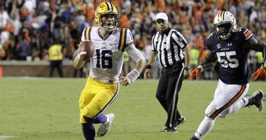 Sep 24, 2016; Auburn, AL, USA; LSU Tigers quarterback Danny Etling (16) looks for a receiver on the last play of the game against the Auburn Tigers at Jordan Hare Stadium. The play was later overturned and the Auburn Tigers beat the LSU Tigers 18-13