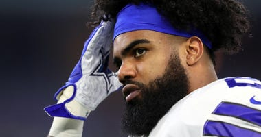 Ezekiel Elliott warms up for the Dallas Cowboys' playoff game against the Seattle Seahawks.
