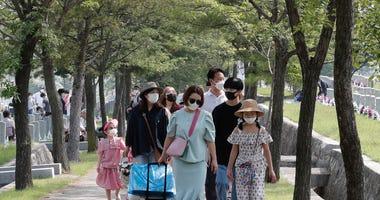 Asia Today: Most of 51 new SKorea cases linked to door sales