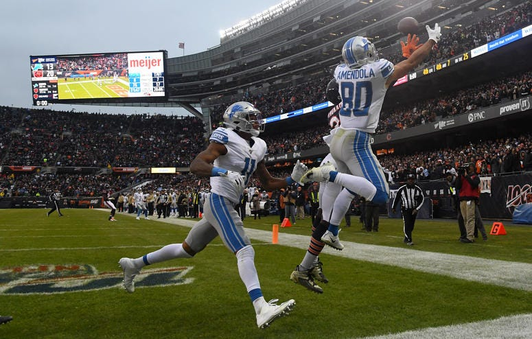 Detroit Lions wide receiver Danny Amendola (80) attempts to make a game tying touchdown on the last play of the game during the second half at Soldier Field.