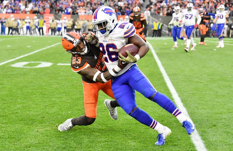 Cleveland Browns free safety Damarious Randall (23) tackles Buffalo Bills running back Devin Singletary (26) during the second half at FirstEnergy Stadium.
