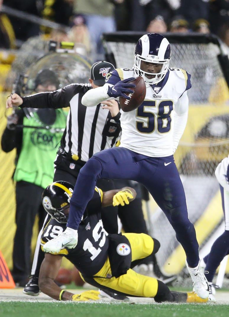 Pittsburgh Steelers wide receiver JuJu Smith-Schuster (19) forces Los Angeles Rams inside linebacker Cory Littleton (58) out of bounds after Littleton recovered a fumble during the second quarter at Heinz Field.