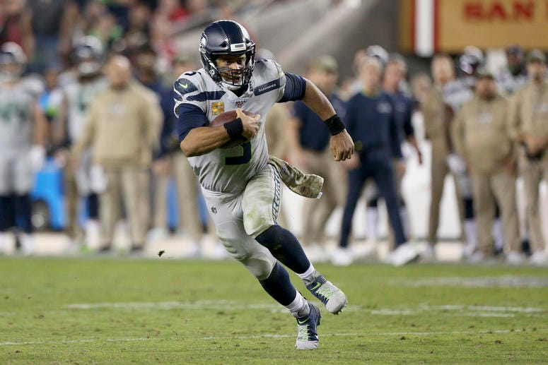 Seattle Seahawks quarterback Russell Wilson (3) runs the ball against the San Francisco 49ers in the third quarter at Levi's Stadium.