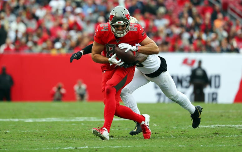 Tampa Bay Buccaneers tight end Cameron Brate (84) catches the ball over New Orleans Saints cornerback Eli Apple (25) during the second half at Raymond James Stadium.