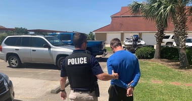 Slidell police arrest the suspect allegedly shown in viral video abusing a dog.