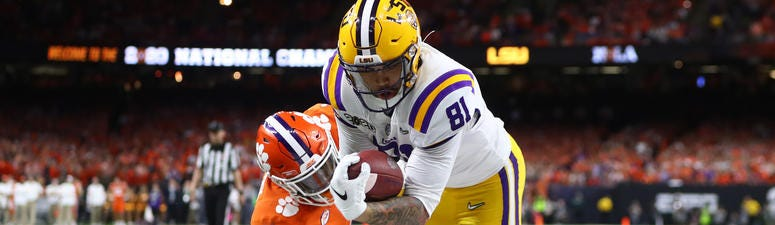 LSU Tigers tight end Thaddeus Moss (81) scores a touchdown past Clemson Tigers cornerback Derion Kendrick (1) in the third quarter in the College Football Playoff national championship game at Mercedes-Benz Superdome.