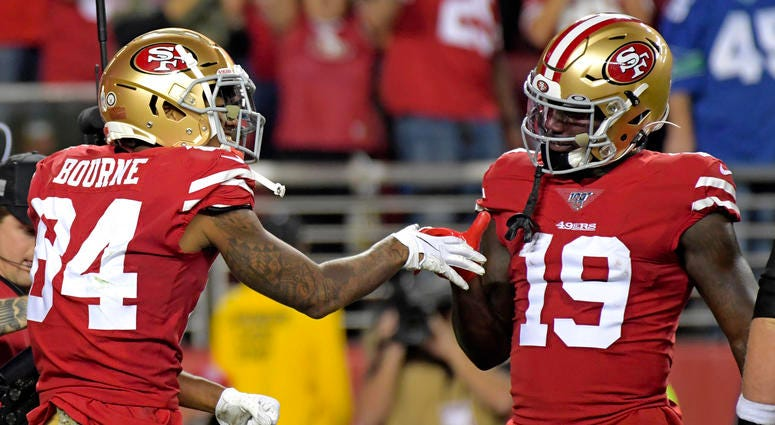 San Francisco 49ers wide receiver Kendrick Bourne (left) celebrates his touchdown next to 49ers wide receiver Deebo Samuel (right) during the first half against the Seattle Seahawks at Levi's Stadium.