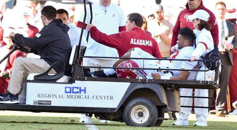 Alabama Crimson Tide quarterback Tua Tagovailoa (13) is carted off the field due to an injury during the second quarter of the game against the Mississippi State Bulldogs at Davis Wade Stadium.