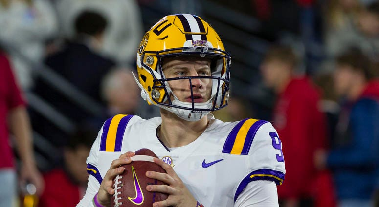 LSU Tigers quarterback Joe Burrow (9) warms up before the game against the Mississippi Rebels at Vaught-Hemingway Stadium.