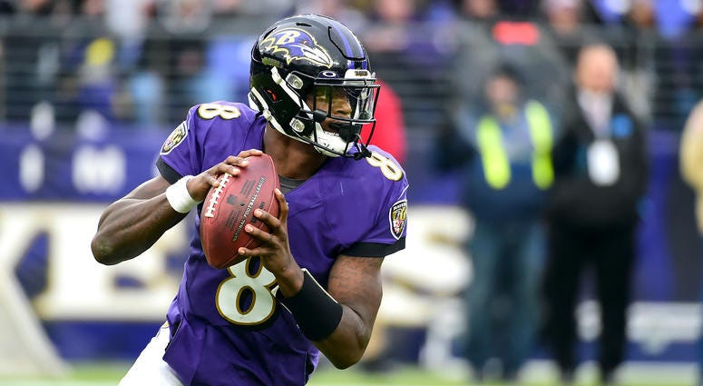 Baltimore Ravens quarterback Lamar Jackson (8) looks to throw in the fourth quarter against the Houston Texans at M&T Bank Stadium.