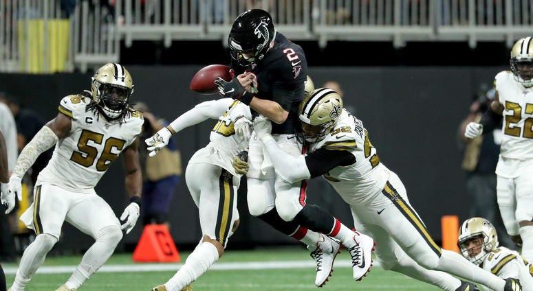 Atlanta Falcons quarterback Matt Ryan (2) fumbles the ball as he is hit by New Orleans Saints cornerback Marshon Lattimore (23) and defensive end Marcus Davenport (92) in the second half at Mercedes-Benz Stadium.