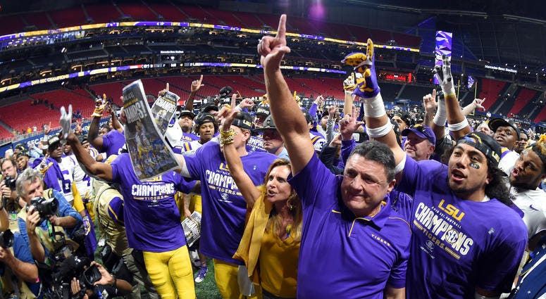 LSU Tigers head coach Ed Orgeron celebrates their 37-10 victory over the Georgia Bulldogs after the 2019 SEC Championship Game at Mercedes-Benz Stadium.