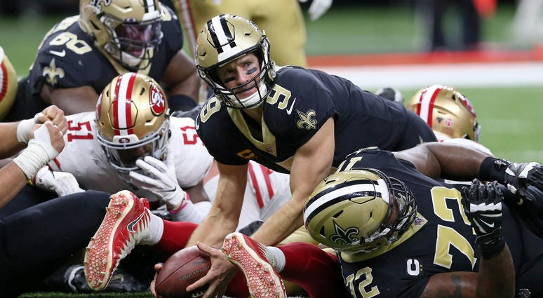 New Orleans, LA, USA; New Orleans Saints quarterback Drew Brees (9) looks up after a touchdown dive in the second quarter against the San Francisco 49ers at the Mercedes-Benz Superdome.