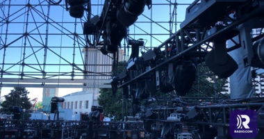 Crews assemble a stage for the College Football Playoff fan events