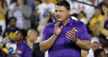 Nov 3, 2018; Baton Rouge, LA, USA; LSU Tigers head coach Ed Orgeron cheers on his players during warmup drills before their game against the Alabama Crimson Tide at Tiger Stadium.