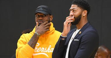 Jul 13, 2019; El Segundo, CA, USA; Los Angeles Lakers forward LeBron James (left) talks with forward/center Anthony Davis (right) after a press conference at the UCLA Health Training Center.