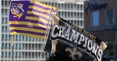 Saints and LSU flags