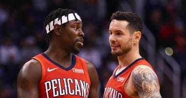 Jrue Holiday and J.J. Redick after the Pelicans win in Phoenix
