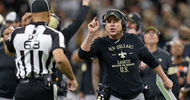 Sean Payton questions a call during Saints/Panthers game