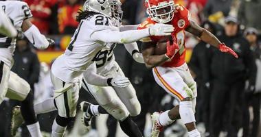 Kansas City Chiefs running back Darwin Thompson (34) runs against Oakland Raiders free safety D.J. Swearinger (21) during the second half at Arrowhead Stadium.