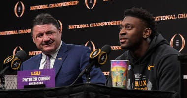 LSU Tigers coach Ed Orgeron (left) and linebacker Patrick Queen during the CFP National Championship champions press conference at the Sheraton New Orleans. LSU defeated Clemson 42-25.