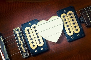 Guitar with a heart shaped pick.