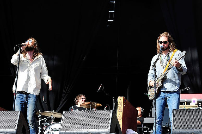 Chris Robinson and Rich Robinson of The Black Crowes perform in concert.
