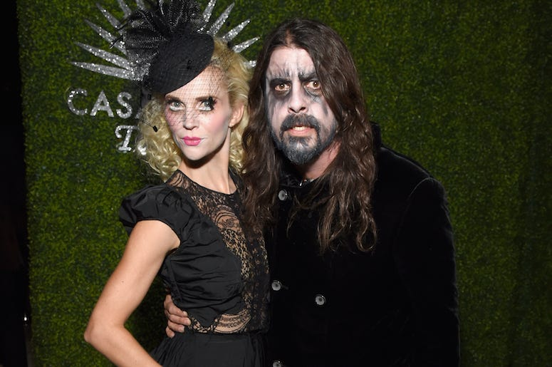 Dave Grohl and his wife Jordyn Blum attend a Halloween party in costumes.