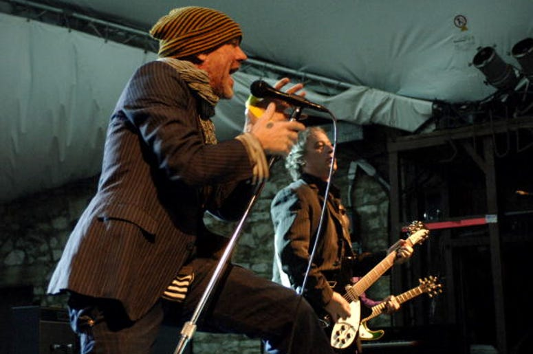 AUSTIN, TX - MARCH 12: Michael Stipe (L) and Peter Buck of REM perform at Stubbs BBQ as part of SxSw 2008 on March 12, 2008 in Austin, Texas. (Photo by Tim Mosenfelder/Getty Images)