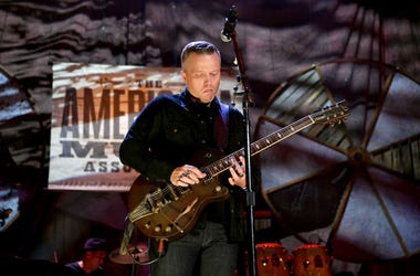 Jason Isbell plays guitar live in concert.