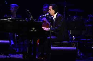 Nick Cave plays piano live in concert.