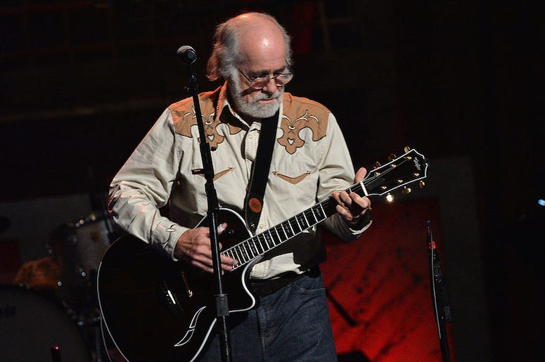 Robert Hunter performs in concert. The Grateful Dead lyricist has died at the age of 78.