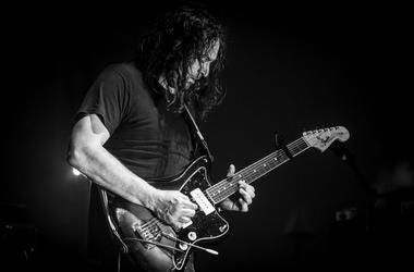 INDIO, CA - APRIL 20: (EDITORS NOTE: Image has been converted to black and white.) Adam Granduciel of The War On Drugs performs onstage during the 2018 Coachella Valley Music And Arts Festival at the Empire Polo Field on April 20, 2018 in Indio, Californi