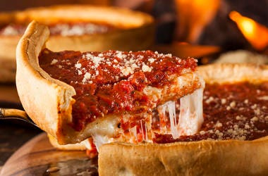 A slice of Chicago style deep dish pizza.