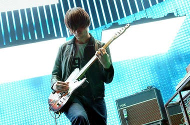 Jonny Greenwood of the band Radiohead plays guitar live in concert.