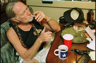 Willie Nelson smoking marijuana