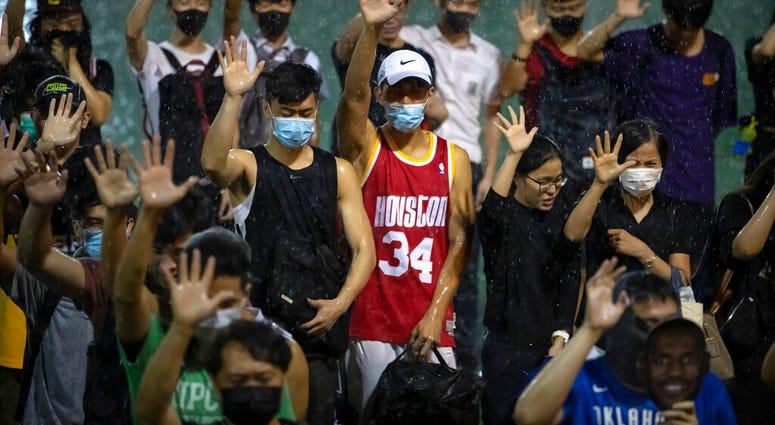 A demonstrator wearing Houston Rockets jersey
