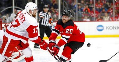 New Jersey Devils center Blake Coleman (20) blocks as Detroit Red Wings defenseman Filip Hronek