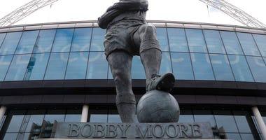 Bobby Moore outside Wembley Stadium in London