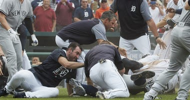 Aug 24, 2017; Detroit, MI, USA; Detroit Tigers manager Brad Ausmus (center) and starting pitcher Justin Verlander (left) try to get players off Detroit Tigers first baseman Miguel Cabrera (bottom right) after benches clear during the sixth inning.