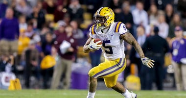 Nov 25, 2017; Baton Rouge, LA, USA; LSU Tigers running back Derrius Guice (5) runs against the Texas A&M Aggies during the fourth quarter at Tiger Stadium.