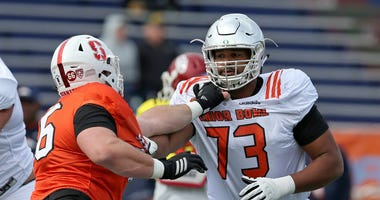 Jan 24, 2018; Mobile, AL, USA; North Squad offensive tackle Tyrell Crosby of Oregon (73) blocks defensive tackle Harrison Phillips of Stanfor (66) during Senior Bowl practice at Ladd-Peebles Stadium.