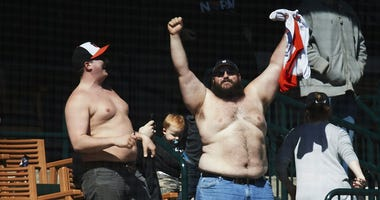 Apr 19, 2018; Detroit, MI, USA; Two shirtless fans in the stand during the ninth inning of the game between the Detroit Tigers and the Baltimore Orioles at Comerica Park.