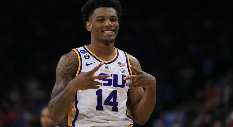 LSU's Skylar Mays (4) goes up for a shot over Yale 's Paul Atkinson (20) and Jordan Bruner (23) during the first half of a first round men's college basketball game in the NCAA Tournament in Jacksonville, Fla., Thursday, March 21, 2019. (AP Photo/John Rao