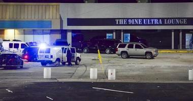 Kansas City, Mo., police crime scene investigators gather