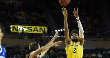 Livers, Simpson Lead Michigan Past Creighton 79-69 In Howard's First True Test